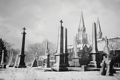 R1-071-34 (David Swift Photography) Tags: davidswiftphotography philadelphia westphiladelphia cemeteries graveyards tombstone monuments graves snow cemeteriesinthesnow churches catholicchurches crosses 35mm film ilfordxp2 olympusstylusepic