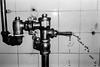 Bladder Control... (Jetlag & A Camera Bag) Tags: toilet bathroom leaking bladder olympus sylus epic 35mm film analog ilford hp5 blackwhite travelphotography streetphotography plumbing water