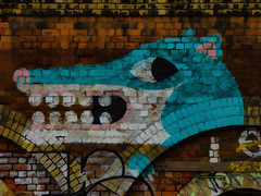 An Egyptian in London (Steve Taylor (Photography)) Tags: coathanger egyptian crocodile teeth hieroglyph animal art digital graffiti tag streetart black blue brown yellow white pink smile brick uk gb england greatbritain unitedkingdom london texture