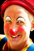 Don't be fooled by the smile ... this clown is a creep ... (daystar297) Tags: streetportrait portrait clown makeup smile funny performer rednose costume nikon colors face people closeup