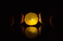 Artistic: Orange (LauraAnaïs) Tags: orange fruit black reflection dark light