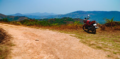 The Motorcycle's moment in the sun! (Bhuvan N) Tags: landscape landscapes nature karnataka india travel landscapephotography biking motorcycle traveling hiking hike mountains kodagu pushagiri nikon nikond60 ngc