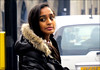 `2234 (roll the dice) Tags: london streetphotography asian pretty sexy uk art classic england urban stranger candid portrait fun funny bored indian tourism tourists reaction people fashion shops shopping unaware unknown cold fur weather face canon hairy westend westminster lights eyes