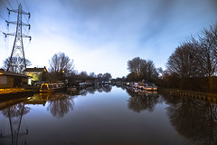 A night to reflect (Paul Wrights Reserved) Tags: reflection reflections night nightphotography nighttime boats canal water pylon tree trees barge canalboat houseboat longexposure