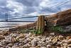 Humber Groin (POCKLINGTON CAMERA CLUB) Tags: wood shoreline neglect landscape bridge wooden humberbridge humber landscapes shore groin hessle sky river pebblebeach bridges weathered pebbles groins decay worn beach water
