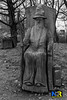 Wizard Wood Carving (Nikon Ranger) Tags: wizard blackandwhite monochrome wood crich treecarving carving chainsaw tree outside outdoors book flash male grass nikon nikond3s woodlandwalk fillinflash chest d3s