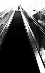 escalator (frax[be]) Tags: streetphotography street urban city subway atmosphere architecture fuji xe3 28mm monochrome noiretblanc dark blackandwhite bnw bw highcontrast