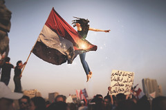 (3/26) Channeling Your Anger for a Cause (Violet Paradise) Tags: egypt egyptianrevolution girl floating flying flag forgiveness conceptual spiritual crowd society middleeast cause anger freedom powerful power spirit liberty youth