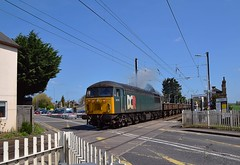 Loco 56303 powers away from Foxton, on the Great Northern Cambridge Branch, with the 11.23 Barrington to Willesden spoil empties. The road here is the busy A10. 18 04 2018 (pnb511) Tags: traction locos locomotives diesels train track class56 levelcrossing road car diesel loco locomotive trains barringtonlightrailway barrington quarry freight dcr