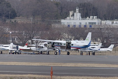 A SMALL AIRPORT, SOME PARKS AND CLOUDS - CXLV (Jussi Salmiakkinen (JUNJI SUDA)) Tags: chofu tokyo japan cityscape park airport sky aircraft wood airplane landscape tama 調布 飛行場 空港 林 森 空 武蔵野 多摩 東京 日本 風景 march clouds spring 2017 maaliskuu turboprop cessna t208 caravan apron