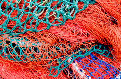 Fishing Nets (Shutterbugsafari) Tags: fishnet sea background net ocean texture rope industrial macro closeup cord knot detail marine line nautical mesh close pattern design catch nylon netting industry fishing blue color boat nobody grid colorful maritime old entangled threads