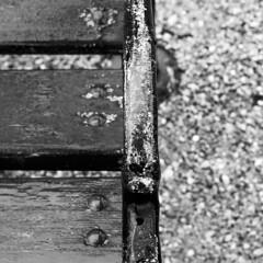 Auf Sissi's Spuren (ManuelaRi) Tags: monochrome deterioration board wood outdoor gravel stone iron bw blackandwhite bench
