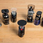 Coffee grinders on the hardwood floor for coarse, medium, and finely ground coffee beans thumbnail