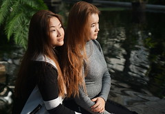 sisters, musing (e³°°°) Tags: sisters girls tibet girl ghent kruidtuin park teenagers tenzin kangli femme female fille face frau flanders filles friends twee two duo vijver portrait portraiture portret posing pond musing daydream daydreaming dream dreaming profile women water