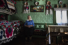 (silvia pasqual) Tags: maramures romania romanian east europe tradition traditional colors indoor home house religion icons human woman portrait portraiture person travel travelling fotocult reportage