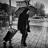 not singing in the rain (digitris) Tags: streetphotography candid street city people woman rain somber umbrella bw blackandwhite monochrome digitris digitri