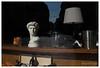 Still life, Milan, Italy (Bigmob Dontwannastop) Tags: still life milan italy urban street statue head sculpture antique shop lamp sunlight bottle wine car moto vitrine glass mirror reflection
