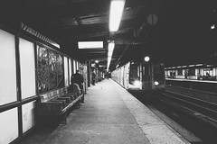 Buenos Noches (0sire) Tags: phonecamera monochrome night station marcyave williamsburg nyc newyorkcity brooklyn people train mtrain mta