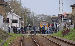 The Mayflower Tour , with 47580 leading the train at Saxmundham Station on the return from Sizewell, on a 12 minute 'leg stretching' break. The passengers have de-trained for photographs. Charity Railtour 15 04 2018