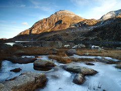 Tryfan (jeff.dugmore) Tags: wales ogwen ogwenvalley nationalpark tryfan mountain water llyn llynogwen northwales snowdonia outside outdoor stone rocks ice sky blue light landscape uk britain europe mountainside hillwalking olympus nisi rural nature countryside