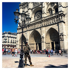A light, a soldier and the religion #43 (Streets.and.Portraits) Tags: paris street basilique notredame france soldier light lamp religion people man military ëledefrance îledefrance fr iphone cathedral