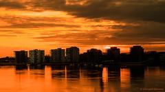 Temse on fire (cstevens2) Tags: reflection schelde temse april cityscape flatgebouwen river rivier skyscrapers sunset water weerspiegeling zonsondergang skyline