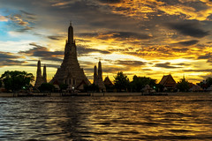 Wat Arun Temple in bangkok thailand at sunset . Day to night (MongkolChuewong) Tags: ancient architecture arun asia attraction background bangkok beautiful blue boat buddhism buildings chao chedi city cityscape culture day dusk famous holiday landmark night orange oriental phraya popular religion religious river sky skyline southeast spirituality stupa sunset temple thai thailand tourism tower traditional travel traveler traveller twilight vacations wat water