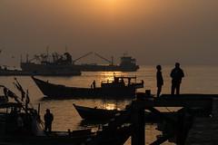 Sunrise on the Bengali Sea (Kathy~) Tags: sunrise bengali sea water silhouette fishingboat boat many 15challengeswinner instagram