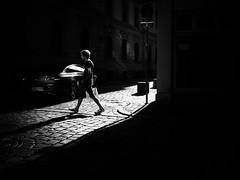 crossing the street (Sandy...J) Tags: atmosphere alone atmosphäre allein light licht monochrom man mann mood city cobblestones contrast walking white blackwhite bw black noir urban deutschland darkness dark olympus fotografie photography street streetphotography sw schwarzweis strasenfotografie stadt stimmung germany