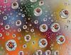 circles inside circles (marianna_a.) Tags: circles macro mondays hmm mariannaarmata smarties water drop drops pattern colour meniscus surface tension