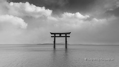 Torii in the clouds (pixellesley) Tags: japan torii shintoshrine gate entrance lake clouds mono blackandwhite snowstormapproaching water wind kyoto lesleygooding landscape walking hiking