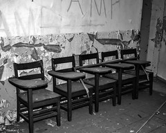 Abandoned South Carolina Mental Hospital: We Don't Need No Education (that_damn_duck) Tags: blackwhite monochrome abandoned urbex urbanexplorer southcarolinamentalhospital hospital schooldesks desk asylum decaying bw blackandwhite nikon
