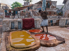 A textile worker prepares to dye fabric  in ancient Alexandria in Assassin's Creed Origins Discovery Tour (mharrsch) Tags: ancient alexandria egypt ptolemaicperiod assassinscreedorigins discoverytour mharrsch dye fabric textile color
