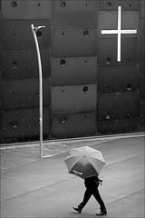 holy rain (bostankorkulugu) Tags: donaucitykirche donaucitychurch vienna wien austria österreich church architecture man walk monochrome korkut bostan bostanci bostankorkulugu white black geometry graphism graphics cross umbrella rain