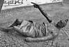 You Pushed Me (tcees) Tags: dobst budapest hungary pest wall statue art floor urban x100 fujifilm finepix sidewalk pavement street bw mono monochrome blackandwhite cobbles carllutz memorial carllutzmemorial budapestjewishdistrict graffiti