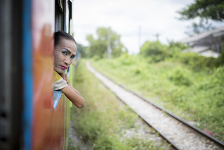 Hanging out of the train wearing make-up, Myanmar