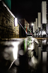 Rock down to electric avenue (Paul Wrights Reserved) Tags: reflection reflections leadinglines electric electricity charging charge chargingpoint focus brickwall puddle night nightphotography nighttime pentax k1 pentaxk1 50mm f14 vanishingpoint longexposure