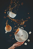Flying coffee cups with saucer, dynamic splashes and falling sugar cubes on a black background. Drinking coffee concept. (Dina Belenko) Tags: action addiction addictive arabica aroma aromatic background barista beverage black break breakfast brew brown caffeine coffee concept conceptual cup delicious drink drop dynamic energy espresso exiting fall flow flying food freeze fun hand hot idea joy kitchen mess motion object pour refreshment relax shake spill splash stilllife sugar tea