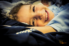 Genuine Smile (Randall ]|[ Photography) Tags: madelyn nc northcarolina tv us unitedstates a6000 beautiful bed daughter girl home indoors kid person photo photographer photography pic picture portrait pretty smile sony winstonsalem