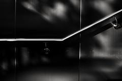 Der Handlauf führt. (Walls Fall Down) Tags: germany deutschland hessen hesse frankfurt bw sw handlauf treppe stairs ubahnstation bockenheimerwarte handrail minimal
