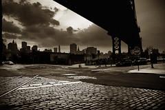 DUMBO in sepia (Ali Brohi) Tags: newyorkcity urban bw 20d sepia brooklyn canon downtown traintracks dumbo manhattanbridge brickstreet downunderthemanhattanbridgeoverpass seedingchaos notsourban moazzambrohicom httpwwwmoazzambrohicom wwwmoazzambrohicom
