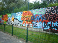 Graffitied side board (hugovk) Tags: uk greatbritain summer england dog geotagged manchester graffiti star unitedkingdom board side august 2006 charm gb lil pitch poo tantrum hvk footy lizzy dogpoo rizz graffitied imag1475 lilrizz geo:lat=5341484 geo:lon=2306453 bbcmanchesterblog