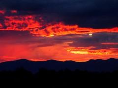 Red Sunset Over Santa Fe, New Mexico (Bill in DC) Tags: sunset newmexico santafe 2006 apex nm santafeopera powershotpro1 natureslight cotcpersonalfavorite abigfave