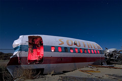 Souther (Lost America) Tags: lightpainting night airplane fullmoon junkyard boneyard airliner startrails aviationwarehouse