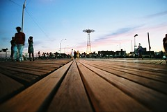 the boardwalk (lomokev) Tags: wood people newyork tower brooklyn canon coneyisland madera dusk perspective boardwalk agfa holz ultra planks agfaultra eos1 vanashingpoint canoneos1 file:name=eos10806d51