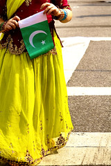 the little colorful Paki (Ali Brohi) Tags: street nyc pakistan people cute 20d festival brooklyn canon little innocent culture celebration pakistani independenceday ethnic mela publicevent seedingchaos subcontinental moazzambrohicom httpwwwmoazzambrohicom wwwmoazzambrohicom