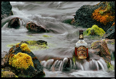 Whisky on the rocks (Mri) Tags: topf25 colors river iceland rocks great whisky regal chivas interestingness89 i500 mri 89onfridayseptember82006 bottlelandscape