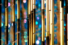 bamboo and blue bokeh (♫ marc_l'esperance) Tags: beads beaded curtains curtain sunlight bokeh bamboo plastic blue green emerald glinting painted black yellow gold purple colour color colours colors outside sunshine sun cml magenta beckwomans commercialdrive eastvancouver reflecting reflective soft hard dof magical mysterious whatliesbeyondthebamboocurtain beauty eyecandy unusual mystery exploreseptember506 interestingness enchanted enchanting contrast 18 3wayicon flickrviewsbug bizpik 2006 vancouver waxystopnotch canonef100300mmf56 canon eos 10d fiveflickrfavs © allrightsreserved luxmaticcom