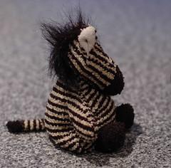contemplating the universe and everything (hedgiecc) Tags: stuffedtoy white black animal toy stripes plush zebra zippy interestingness245 i500 2006highlight