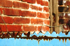 2006-10-08 Inspired ([ henning ]) Tags: red urban abstract building brick texture abandoned neglect fence wow d50 germany spiky nikon rust industrial factory dof decay bricks north rusty 2006 odd rusted oxidation land nrw wuppertal bergisches oxidize bergischesland spikes nordrheinwestfalen corrosion henning sordid tarnish tristesse verlassen abstrakt decompose corrode rhinewestphalia mühlinghaus heckinghausen wuppertalheckinghausen muehlinghaus
